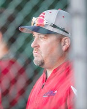 Cane Cutters head coach Ricky VanAsselberg watches from the dugout as the Acadiana Cane Cutters take on the Texarkana Twins at Fabacher Field Wednesday, June 19, 2019.