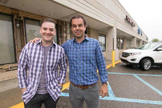 Bret Borock, left, and Matthew Grabowski have opened three Orangetheory Fitness studios in Michigan and will open their fourth in the Brighton Mall,  seen Thursday, June 20, 2019.