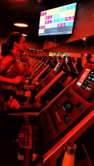 A group fitness class works out on treadmills at Orangetheory Fitness in Ann Arbor. The studio's co-owners are opening a new location in the Brighton Mall later this year.