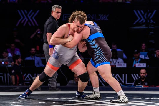 Fowlerville's Adam Coon (left) beat Cohlton Schultz of Colorado on Saturday, June 15, 2019 to earn a berth in the Senior World Wrestling Championships.