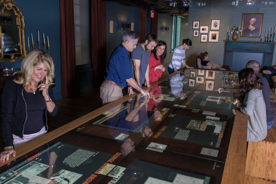 "A digitized ""dining room table"" at the Frazier History Museum tells the stories of people, places and events that make up Kentucky's bourbon history."