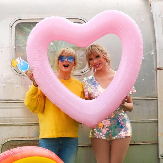 "Taylor Swift, left, with drag queen Jade Jolie, who played Swift in the ""You Need to Calm Down"" music video."