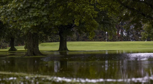 Unintentional water hazards around a grove of trees by the 2nd green, seen Thursday, June 20, 2019, at Forest Akers West Golf Course in East Lansing.  The course was closed today.