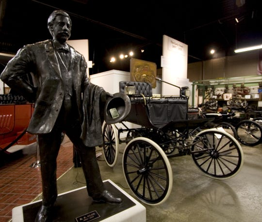 A statue of automotive pioneer R.E. Olds, created by artist Nancy Leiserowitz, is displayed at the R.E. Olds Museum in Lansing.