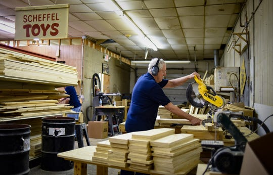 Volunteer toymaker Wayne Wysack, 77, of Lansing, uses a chopsaw to shape toy ironing tables  Wednesday, June 19, 2019, at the R.J. Scheffel Memorial Toy Project woodshop based in DeWitt Township.  Staffed entirely by volunteers, toymakers produce over 9,000 handmade wooden toys throughout the year and donate them to low-income families, children's hospitals, rehabilitation centers, and counseling and grieving centers for kids.