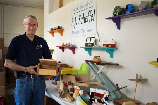 Roy Ketcheson, 84, of Mason shows one of the memory boxes produced by R.J. Scheffel Memorial Toy Project toymakers in Lansing on June 19, 2019.  Staffed entirely by volunteers, toymakers produce over 9,000 handmade wooden toys throughout the year and donate them to low-income families, children's hospitals, rehabilitation centers, and counseling and grieving centers for kids.  Ketcheson figures over a ten year period, he's probably make over 10,000 boxes.