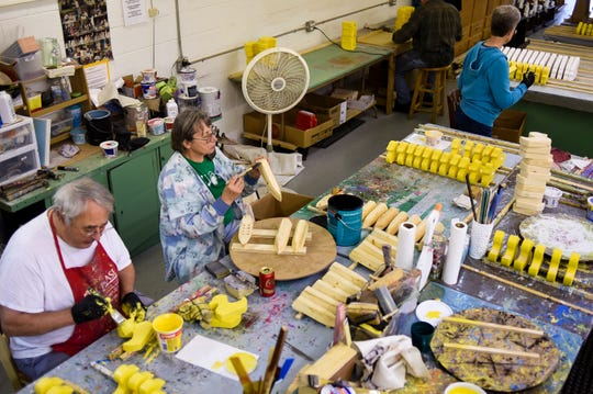 Volunteer toymakers Rich Patterson, 76, of East Lansing, and Carol Wade, 69, of Perry, put the finishing touches on wooden toys, Wednesday, June 19, 2019, at the R.J. Scheffel Memorial Toy Project woodshop in DeWitt Township.  Staffed entirely by volunteers, the organization produces over 9,000 handmade toys throughout the year that are donated to low-income families, children's hospitals, rehabilitation centers, and counseling and grieving centers for kids.