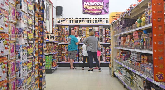 Shoppers have many aisles to scour looking for fireworks at Phantom Fireworks on Koogle Road.