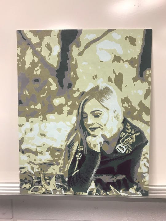 This painting, a self-portrait, earned Makenna Heimlich an award at the  Mid-Ohio Artpalooza.