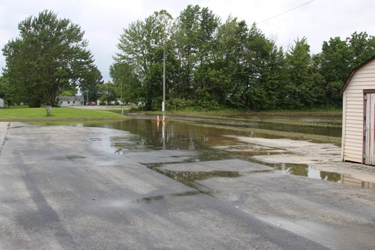 Water creeps up on the edge of the parking lot of the Kiwanis Village apartment complex in LaRue Thursday afternoon. A few of the residents at the complex were evacuated the night before as the area was forcasted to get up to 3 inches of rain.