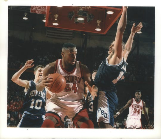 Sophomore center Rashard Griffith takes the ball to the hole against Penn State's John Amaechi in 1995.