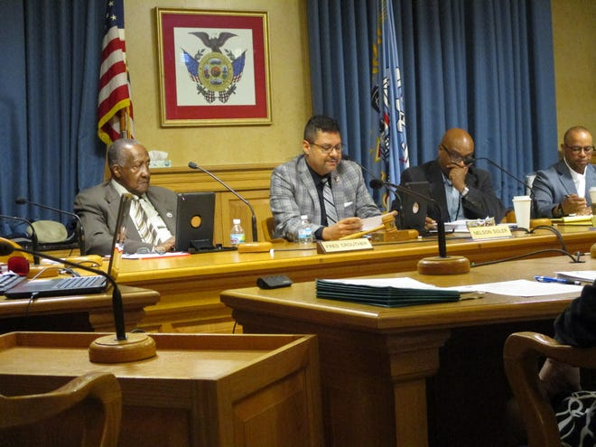 The Fire and Police Commission listens to community activist Paul Mozina's public comment.