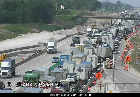 This Wisconsin Department of Transportation freeway camera photo shows northbound traffic backed up on I-94/41 at Ryan Road. The northbound lanes of the freeway are closed because of a crash and traffic is being diverted off the freeway at Drexel Ave.