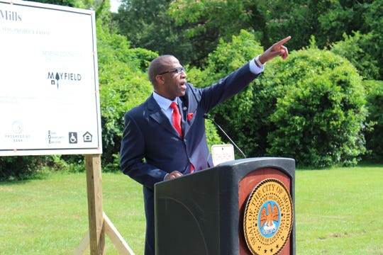 Monroe Housing Authority Executive Director William Smart speaks at a Thursday ground breaking for the Preservation Mills community. Twenty-three new single-family homes will be constructed along South Third and South Fourth Streets as part of a $3.5 million neighborhood revitalization initiative.