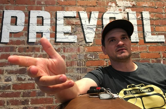 Prevail Union owner Wade Preston talks tech at his downtown Montgomery coffee shop.