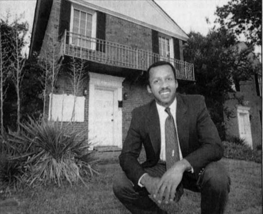 Bryan Stevenson poses in front of EJI's original Clay Street office space in 1995.