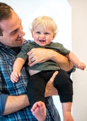 Taylor Murphy plays with his son, Owen, 1, at their home Wednesday, June 19, 2019, in Nashville. When Owen was born, Murphy was offered 12 weeks of paid leave from his Silicon Valley employer GitLab. He took less than two.He now encourages other parents to take more time off.