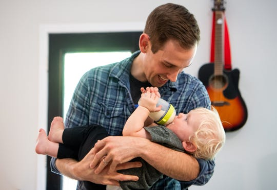 Taylor Murphy holds his son, Owen, 1, at their home Wednesday, June 19, 2019, in Nashville.