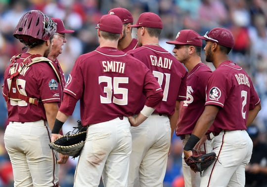 Florida State head coach Mike Martin talks to his infielders and pitcher Conor Gracy (31) at the mound during the game against Texas Tech in the 2019 NCAA Men's College World Series at TD Ameritrade Park Wednesday, June 19, 2019, in Omaha, Neb.