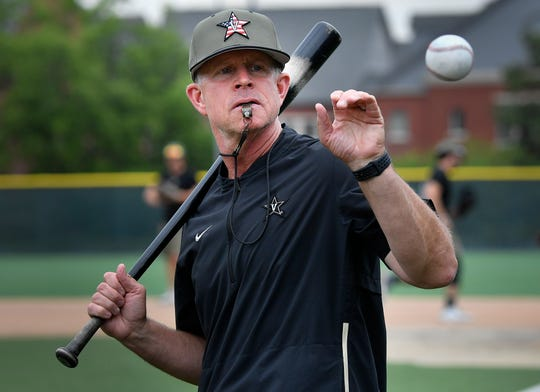 Vanderbilt head coach Tim Corbin catches a ball as he hits grounders to the infield during a practice at Creighton University on their day off in the 2019 NCAA Men's College World Series Thursday, June 20, 2019, in Omaha, Neb.