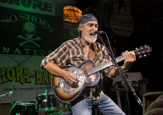 Tony Brook, of Waverly, Ala., performs at the Flora-Bama Lounge in Perdido Key, Fla., on Wednesday, June 19, 2019.
