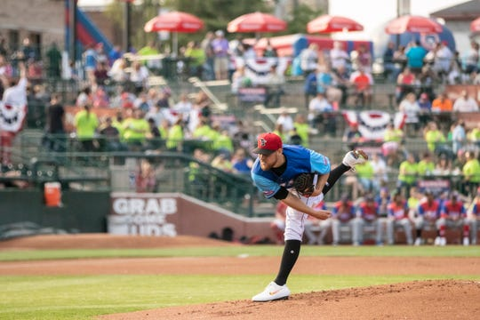 Estero graduate Josh Winckowski delivers a pitch in the first inning of the Midwest League All-Star game Tuesday in South Bend, Indiana. Winckowski worked a 1-2-3 inning with a strikeout for the East squad, representing the Lansing Lugnuts. Winckowski was called up to the Dunedin Blue Jays of the Class A-Advanced Florida State League after the game.