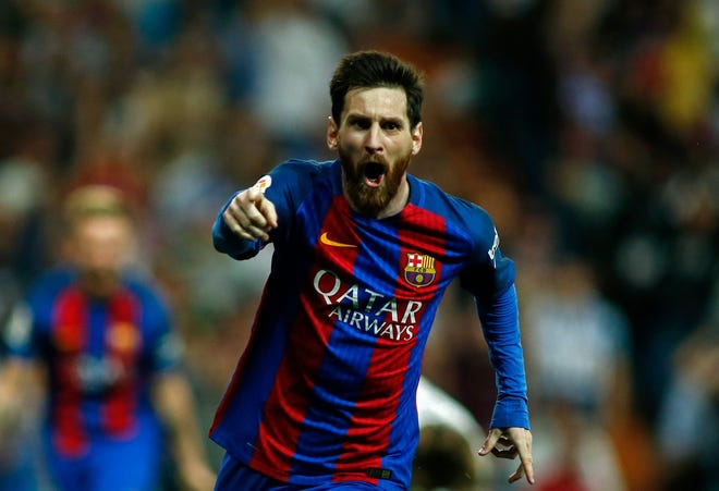 FC Barcelona forward Lionel Messi celebrates after scoring during the Spanish League Clasico match against Real Madrid on Sunday in 2017.