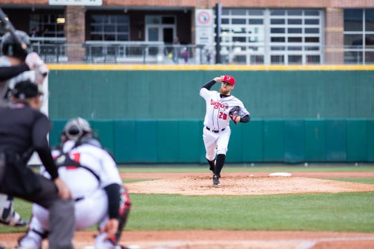 Estero graduate Josh Winckowski delivers a pitch for the Lansing Lugnuts in a game against the Dayton Dragons on April 20 in Lansing, Michigan. Winckowski tossed six shutout innings as the Lugnuts won, 4-0.