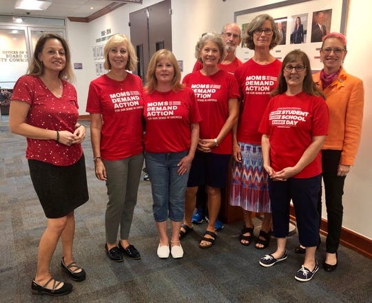Members of Moms Demand Action for Gun Sense in America and the Collier County Education Association gather outside of a county commission meeting on Thursday.