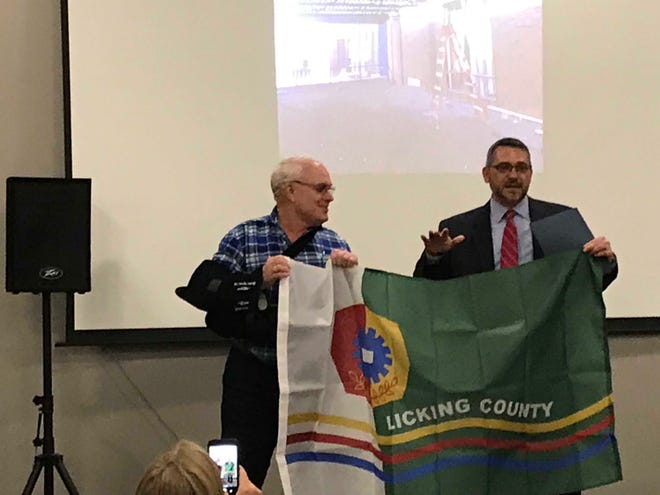 Licking County Board of Developmental Disabilities superintendent/CEO Jason Umstot speaks after receiving a county flag Thursday from commissioner Rick Black during the re-dedication of the E.S. Weiant Center.