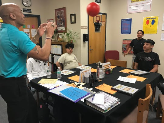 Students at Frelinghuysen Middle School participate in a mentoring program called Boys 2 Men. It's one of the programs to teach and incentivize positive behaviors.