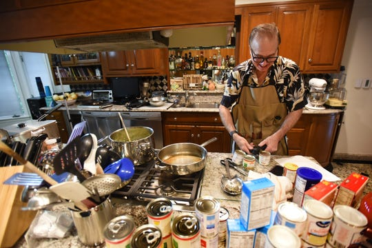 "Robert Solomon of Norwood, who is trying to get this ""Summersgiving"" established as a national holiday, prepares to cook Broccoli Supreme as part of ""Summersgiving"" feast at the kitchen of his home in Norwood on 06/20/19."