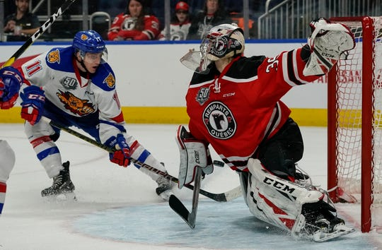 Goalie Anthony Morrone #39 of the Quebec Remparts makes a save on Jakob Pelletier #11 of the Moncton Wildcats during their QMJHL hockey game at the Videotron Center on November 20, 2018 in Quebec City, Quebec, Canada.