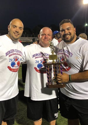 TJ Kroncke, center, has been named new head football coach at Pal Park/Leonia. Here he is after the Bergen All-Star football game with coach Joseph Gingerelli, left, and Lyndhurst coach Rich Tuero.