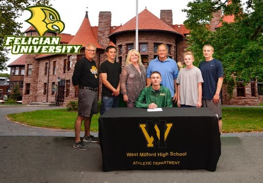 West Milford's Josiah Basket, center, signed with Div. II Felician College earlier this month with his family and coach by his side.