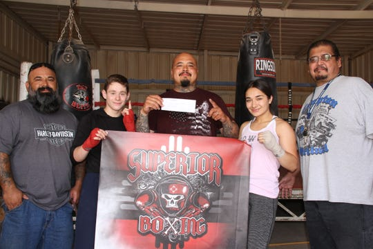 The Deming Moose Lodge 2088 awarded $600 to Superior Boxing Club's boxers Marisol Denogean, 15, and Ezequiel Sandoval, 14. The funds will pay part of their expenses when attending the National Jr. Olympics starting Sunday, June 23 through Saturday, June 29, in Madison, Wisconsin.
