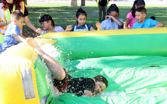The City of Deming Summer Recreation program enjoyed a cool down on Wednesday with a giant water slide at the Shedden Memorial Courts near the old Deming High School. Close to 500 children have signed up for the summer program that runs six weeks for ages 5-14. The children meet from 8 a.m. to noon, Monday through Friday for fun recreational activities provided at the Hofacket Campus at DHS and the city parks. All children are welcome and participation is free.