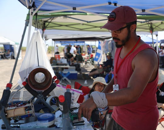 Edgar Salas, from the University of Nevada-Las Vegas, works on his team's rocket, Thursday, June 20, 2019. This is the school's first year competing in the Spaceport America Cup.
