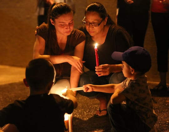 "Francisco ""Paco"" Tarin's aunt Jasmine Tarin, left, and his girlfriend, Ana Treviño, light candles Wednesday, June 19, 2019, in remembrance of their loved one who was killed in a shootout with police early Monday morning."