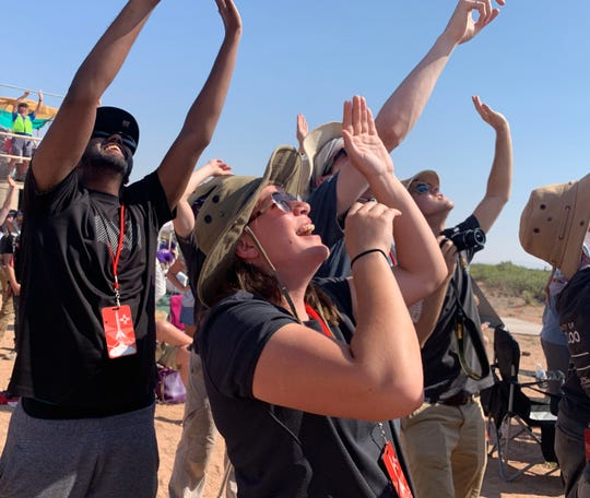 Members of the Waterloo University rocketry team celebrate the successful launch of their rocket during the third annual Spaceport America Cup on Thursday, June 20, 2019.