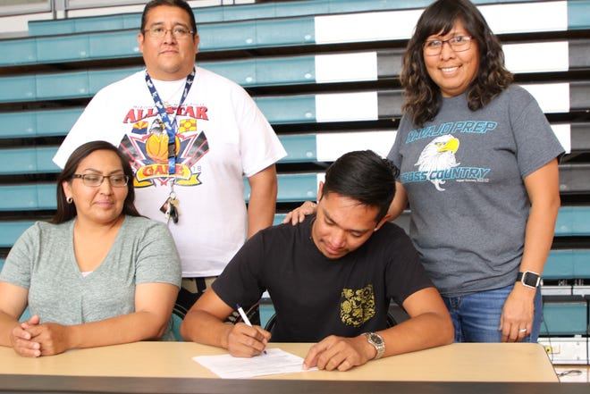Navajo Prep's Tyrese Begay signs his national letter of intent on Thursday to continue his cross country and track career at Ottawa University in Surprise, Arizona.