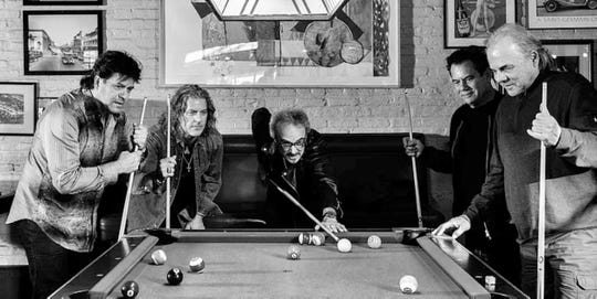 Pablo Cruise playing pool and enjoying life. Larry Antonino, Robbie Wyckoff, Dave Jenkins, Cory Lerios and Steve Price (from left to right.