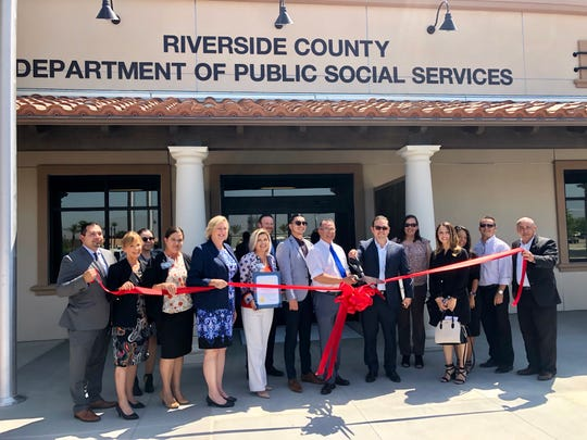 County and city officials including Riverside County Supervisor Manuel Perez and Coachella Mayor Steven Hernandez hold a ribbon-cutting ceremony for the new Riverside County social services building in downtown Coachella.