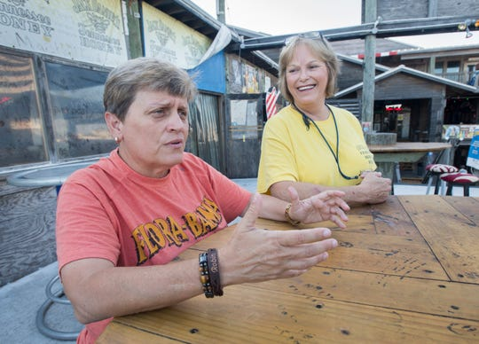 Flora-Bama night manager Robin Lusk, left, customer service lead Janice Curtis talk about their efforts to help evacuate residents from the massive fire that broke out early Wednesday in the 17000 block of Perdido Key Drive that destroyed at least 26 condo units.