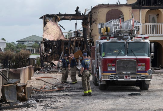 Escambia County firefighters continue to search for hot spots in and around the Key Harbour Condominiums on Thursday, June 20, 2019. On Wednesday a fast-moving fire destroyed multiple condo units in the complex as well as two other nearby structures.