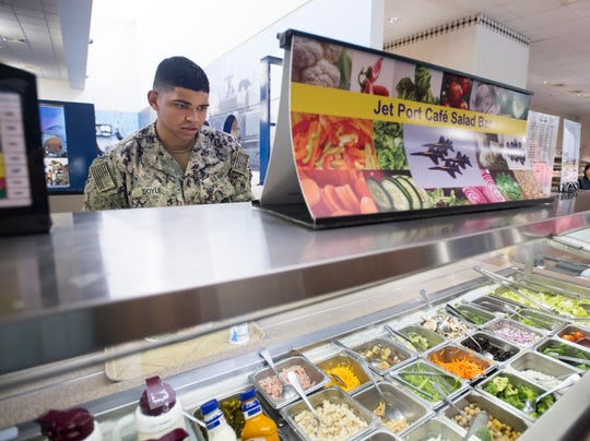 Sailor Nickolas Doyle, 20, checks out his options at the salad bar at NAS Pensacola's NATTC Galley on Tuesday, June 19, 2019.