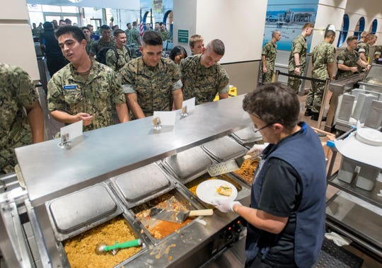 Sailors and Marines make their way through the lunch line at NAS Pensacola's NATTC Galley on Tuesday, June 19, 2019.