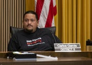 Phoenix Councilman Carlos Garcia listens to the public during a City Council meeting.