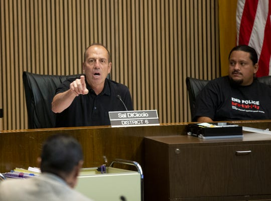 Councilman Sal DiCiccio, left, exchanges words with the public during a Phoenix City Council meeting regarding the Phoenix Police Department and police brutality.