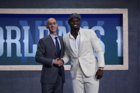 Zion Williamson greets NBA Commissioner Adam Silver after being selected No. 1 overall by the New Orleans Pelicans.